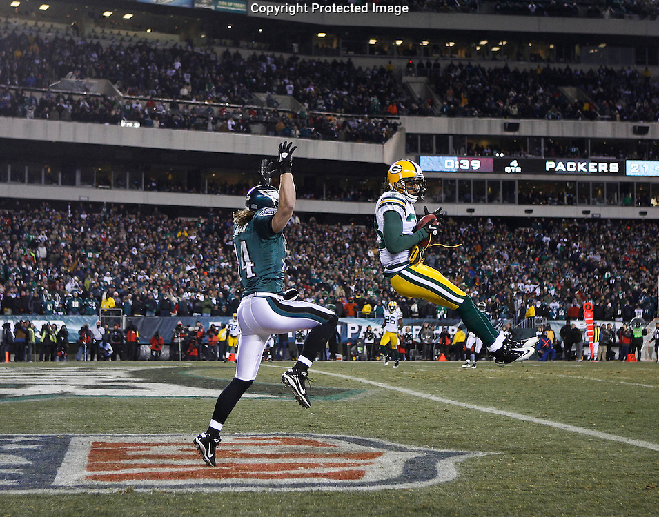 Green Bay Packers cornerback Tramon Williams #38 catches a pass for an interception in the last minute of play during the NFL Wild Card Playoff Game between the Green Bay Packers and the Philadelphia Eagles. The pass was intended for Philadelphia Eagles wide receiver Riley Cooper #14 and the Packers won 21-16 at Lincoln Financial Field in Philadelphia, Philadelphia on Sunday January 9th 2011. (Photo By Brian Garfinkel)