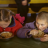 MONGOLIA, Darhad Valley. Students at Rinchenlhumbe boarding school eat noodles for lunch in the cafeteria.