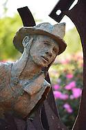 Garden City, New York, U.S. - August 29, 2014 - Adelphi University campus outdoor sculpture in terra cotta and metal of 9/11 theme by artists artist Dan Christoffel in summer