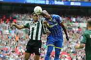 Tom Elliott forward for AFC Wimbledon (9), jumps with Plymouth Argyle defender Curtis Nelson (5) during the Sky Bet League 2 play off final match between AFC Wimbledon and Plymouth Argyle at Wembley Stadium, London, England on 30 May 2016. Photo by Stuart Butcher.