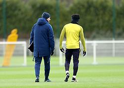 Tottenham Hotspur manager Mauricio Pochettino (left) with Tottenham Hotspur's Danny Rose during the training session at Tottenham Hotspur Football Club Training Ground, London.