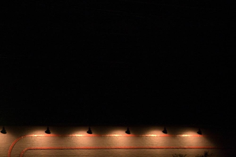 Lights illuminate the side of the Main Street Market in Downtown Charlottesville Virginia.
