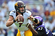 FORT WORTH, TX - SEPTEMBER 13:  Mitch Leidner #7 of the Minnesota Golden Gophers scrambles against the TCU Horned Frogs on September 13, 2014 at Amon G. Carter Stadium in Fort Worth, Texas.  (Photo by Cooper Neill/Getty Images) *** Local Caption *** Mitch Leidner