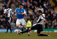 Photo: Richard Lane.<br />Birmingham City v West Bromwich Albion. The Barclays Premiership. 11/03/2006. <br />Birmingham's Martin Taylor (L) is challenged by West Brom's Paul Robinson.