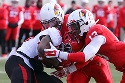 08 November 2014: Alex Donnelly and Dion Starnes close the gap on Martin Ruiz (TB) during an NCAA Missouri Valley Football Conference game between the Youngstown State Penguins and the Illinois State Redbirds at Hancock Stadium in Normal Illinois