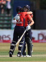 England's captain Heather Knight and Nat sliver celebrate victory during the Women's Vitality International T20 Tri-Series Final at The CloudFM County Ground, Chelmsford.