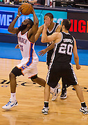 June 2, 2012; Oklahoma City, OK, USA; Oklahoma City Thunder guard James Harden (13) is fouled by San Antonio Spurs guard Danny Green (4) as guard Manu Ginobili (20) looks on during a playoff game  at Chesapeake Energy Arena.  Thunder defeated the Spurs 109-103 Mandatory Credit: Beth Hall-US PRESSWIRE
