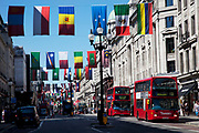 Flags from all nations in the World hang across streets in the West End of London, UK. Here on Regent Street in celebration of the 2012 Olympic Games, this part of central London is filled with colour.