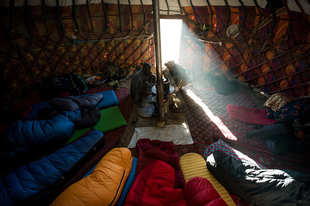 """6 westerners, 6 Afghans, 1 yurt. Being invited to use a yurt for the night meant our first chance to sleep away from the relentless wind that battered our tents. The Kyrgyz villages often have a """"guest yurt"""" something that seems unlikely to us in such a remote place, but given the harsh environment and changeable weather, it is part of the custom to offer this to passing travellers."""
