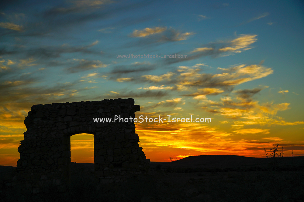 An old dilapidated building in the desert at sun set, Negev, Israel