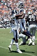 Los Angeles Rams cornerback Dominique Hatfield (36) and Los Angeles Rams defensive back Isaiah Johnson (27) leap and celebrate after stopping Oakland Raiders running back Jalen Richard (30) on a third down play in the first quarter during the 2018 NFL preseason week 2 football game against the Los Angeles Rams on Saturday, Aug. 18, 2018 in Los Angeles. The Rams won the game 19-15. (©Paul Anthony Spinelli)