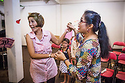 """31 MARCH 2013 - BANGKOK, THAILAND: """"Nok"""" (left) and """"Nim"""" dance during Easter services at the Thai Peace Foundation office in the Bangkapi section of Bangkok.     PHOTO BY JACK KURTZ"""
