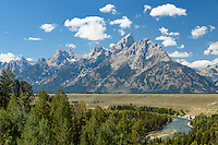The Teton Mountains tower in the distance while rafters make their way down the Snake River.