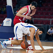 Anadolu Efes's Cenk AKYOL (F) during their Two Nations Cup basketball match Anadolu Efes between Olympiacos at Abdi Ipekci Arena in Istanbul Turkey on Sunday 02 October 2011. Photo by TURKPIX