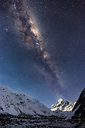 Sure, you can conquer Mount Cook, New Zealand's highest peak at 3,724m (12,218 feet), but that's just the start of the mighty Milky Way!<br /> <br /> Like a beacon at night, the moonlit Mount Cook appears to project the Milky Way and its galactic core across the night sky, in Mt Cook National Park, New Zealand.