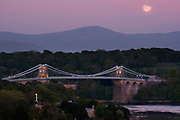 A full moon arose in the glowing pink of dusk but as it ascended a bank of soft cloud gently obscured it's luminosity