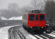 © Licensed to London News Pictures. 18/01/2013. London, UK A District Line tube train in the snow. Snow in West London today 18th January 2013. Photo credit : Stephen Simpson/LNP
