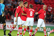 Joe Ledley of Wales celebrates his penalty goal with Craig Bellamy (8). friendly international match, Wales v Luxembourg at the Parc y Scarlets stadium in  Llanelli on Wed 11th August 2010. pic by Andrew Orchard, Andrew Orchard sports photography,