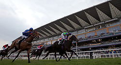 Burford Brown ridden by jockey James Doyle (centre) winning the Ascot Supports Racing Charities Handicap during Royal Ascot Trials Day at Ascot Racecourse.