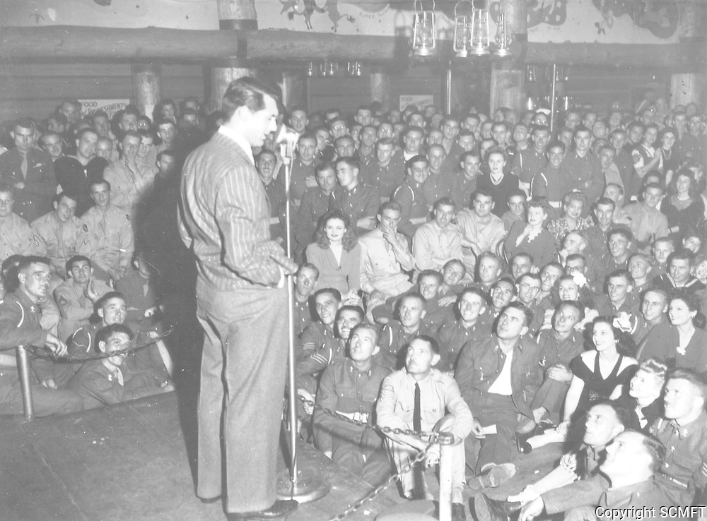 1944 Cary Grant entertains servicemen and volunteers at the Hollywood Canteen