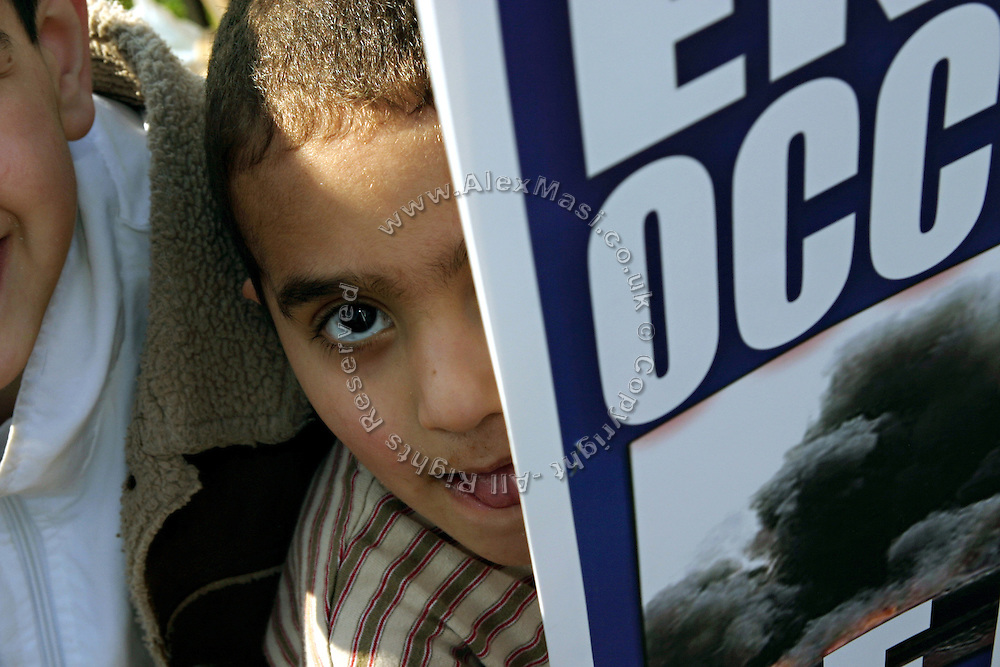 Child behind an anti-war poster during a demonstration held in central London, UK, on Saturday, March 19, 2005. **ITALY OUT**