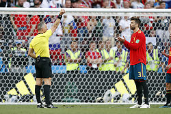 (l-r) referee Bjorn Kuipers, Gerard Pique of Spain during the 2018 FIFA World Cup Russia round of 16 match between Spain and Russia at the Luzhniki Stadium on July 01, 2018 in Moscow, Russia