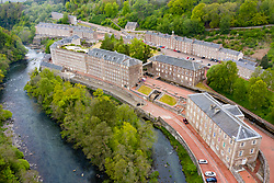 Aerial view of New Lanark World Heritage Site beside River Clyde in South Lanarkshire, Scotland, UK