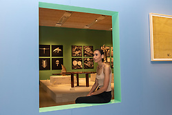 """© Licensed to London News Pictures. 17/06/2021. LONDON, UK. A model poses in gallery space. Preview of """"Charlotte Perriand: The Modern Life"""" exhibition at the Design Museum in Kensington. Charlotte Perriand's (1903-1999) pioneering furniture designs shaped the 20th century and helped define the modern interior.  The exhibition marks the 25th anniversary of her first exhibition at the Design Museum in 1996 and runs 19 June to 5 September 2021. Photo credit: Stephen Chung/LNP"""
