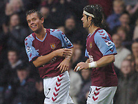 Credit: Back Page Images. Aston Villa v Fulham, FA Premiership, 23/10/2004. Lee Hendrie celebrates scoring the 2nd Aston Villa goal with Juan Pablo Angel
