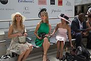 Royal Ascot racegoers at Waterloo station. London. 19 June 2013.