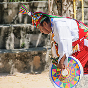 Traditional dancer in full costume performing a Maya dance at Xcarat Maya theme park south of Cancun and Playa del Carmen on Mexico's Yucatana Peninsula.