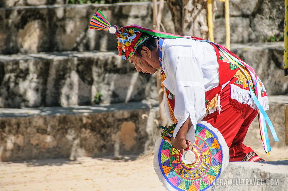 Traditional dancer in full costume performing a Maya dance at Xcarat Maya theme park south of Cancun and Playa del Carmen on Mexico's Yucatana Peninsula.