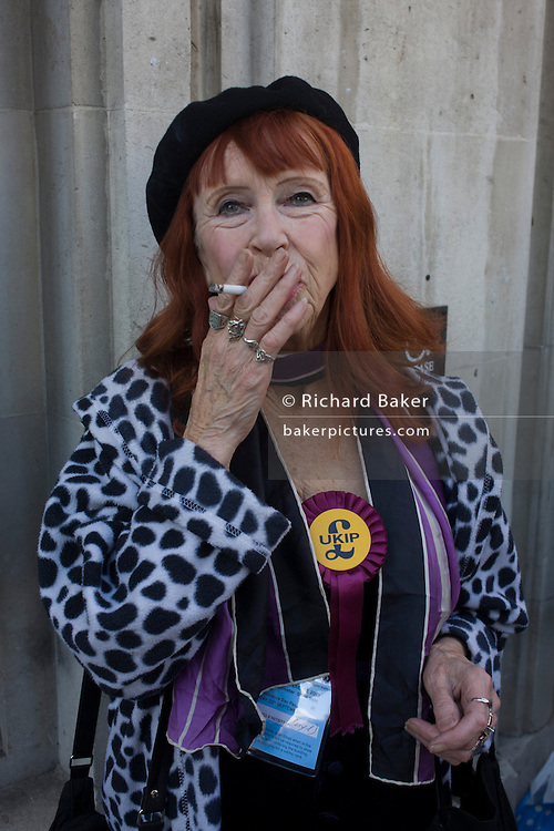 A woman UKIP (UK Independence Party) member smokes a cigarette outside the party conference in Westminster, central London.