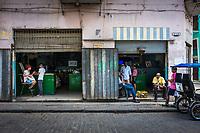 HAVANA, CUBA - CIRCA MAY 2016: Typical corner in centro Havana with locals.