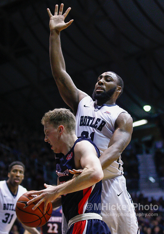 INDIANAPOLIS, IN - DECEMBER 28: Reece Chamberlain #22 of the Belmont Bruins dribbles the ball as Roosevelt Jones #21 of the Butler Bulldogs defends at Hinkle Fieldhouse on December 28, 2014 in Indianapolis, Indiana. (Photo by Michael Hickey/Getty Images) *** Local Caption *** Reece Chamberlain; Roosevelt Jones