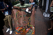 Artist Reggie Gillumo tries to sell postcards of a painting he created of President Barack Obama on the streets outside of the 2012 Democratic National Convention on Tuesday, September 4, 2012 in Charlotte, NC.