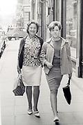woman friends walking in the street Paris ca 1960s