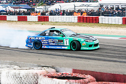 Cars take part in a drifting show at the Nürburgring circuit.