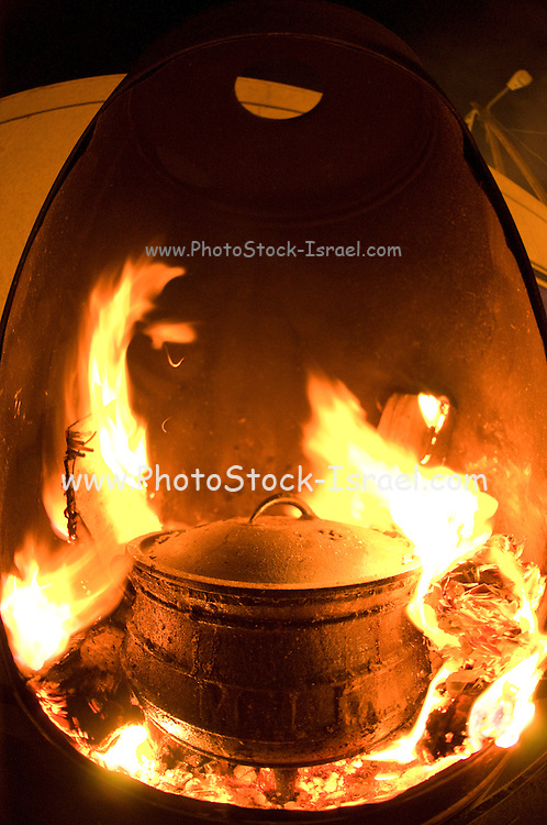 Outdoor cooking on an open fire