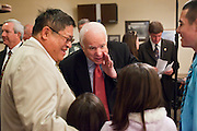 15 FEBRUARY 2010 -- TEMPE, AZ: Sen. John McCain (CENTER) talks to Mayor Michael Hing (LEFT) from Superior, AZ, and his children; Ally Michael Hing, 7, Augustine Hing, 8, Naomi-Bo Hing, 10, and Altin Hing, 15, (FAR RIGHT) before McCain's press conference at American Legion Hall Post 2 in Tempe Monday morning. McCain introduced more than 30 mayors from across Arizona that have or will be endorsing him in his primary against former TV sports anchor and Congressman J.D. Hayworth. Hayworth, an arch conservative, is running against McCain for being too liberal on spending and immigration.   PHOTO BY JACK KURTZ