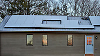 South facing solar panels with a light coating of snow. Winter Nature in New Jersey. Image taken with a Nikon Df camera and 70-200 mm f/2.8 lens (ISO 400, 70 mm, f/2.8, 1/400 sec).
