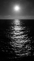 Pathway to the Sun, from the deck of the MV World Odyssey.  Image taken with a Leica T camera and 18-56 mm lens (ISO 100, 23 mm, f/14, 1/4000 sec). Processed with Capture One Pro (including conversion to B&W), and Photoshop CC.