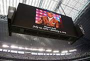 A tribute to deceased ESPN sports reporter Stuart Scott is displayed on the overhead scoreboard and television screen as the crowd is asked to give a moment of silence before the Dallas Cowboys NFL week 18 NFC Wild Card postseason football game against the Detroit Lions on Sunday, Jan. 4, 2015 in Arlington, Texas. The Cowboys won the game 24-20. ©Paul Anthony Spinelli