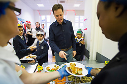 © London News Pictures. 17/12/2013 . London, UK. Deputy Prime Minister NICK CLEGG queueing up to be served food during a visit to St Clements Danes Primary School in London in which he ate Christmas lunch with the students. Photo credit : Ben Cawthra/LNP
