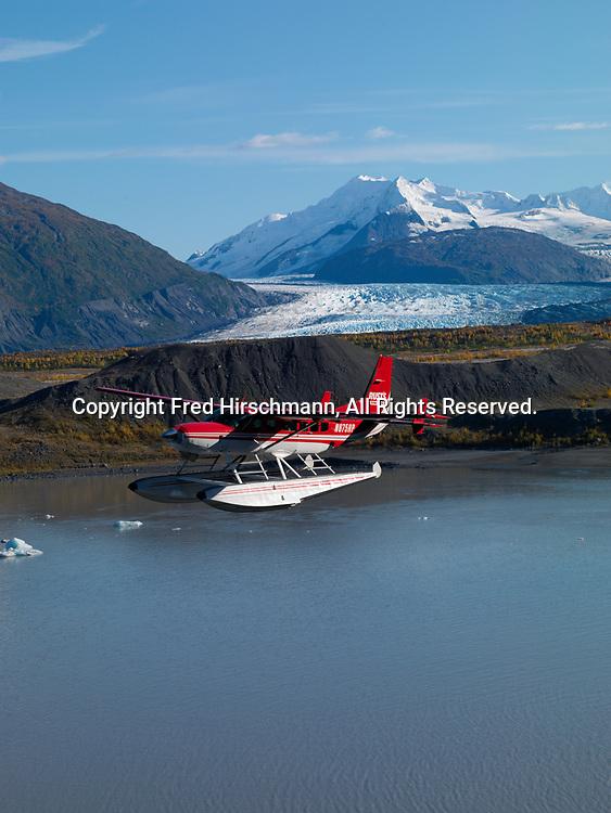 Rust's Flying Service Cessna 208 Caravan on floats flying above Lower Lake George, Alaska.