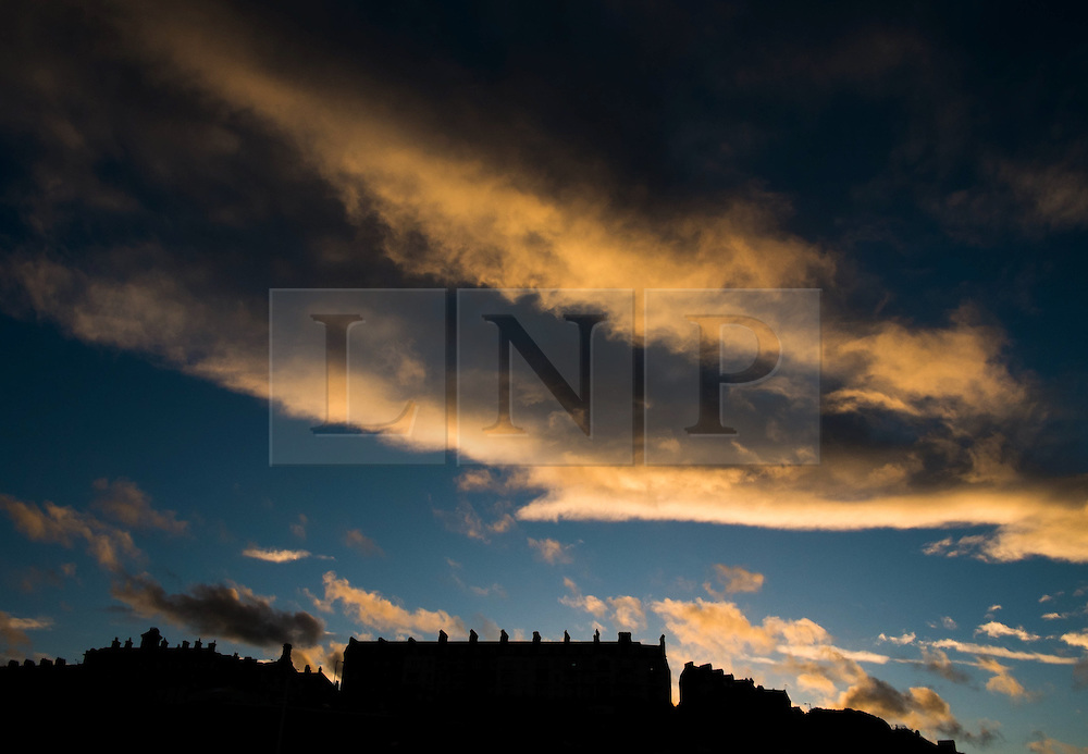 © Licensed to London News Pictures. 18/03/2014<br /> <br /> Saltburn, England <br /> <br /> The houses on the Upper Promenade are seen in silhouette as the sun sets and illuminates the clouds in Saltburn by the Sea.<br /> <br /> Photo credit : Ian Forsyth/LNP