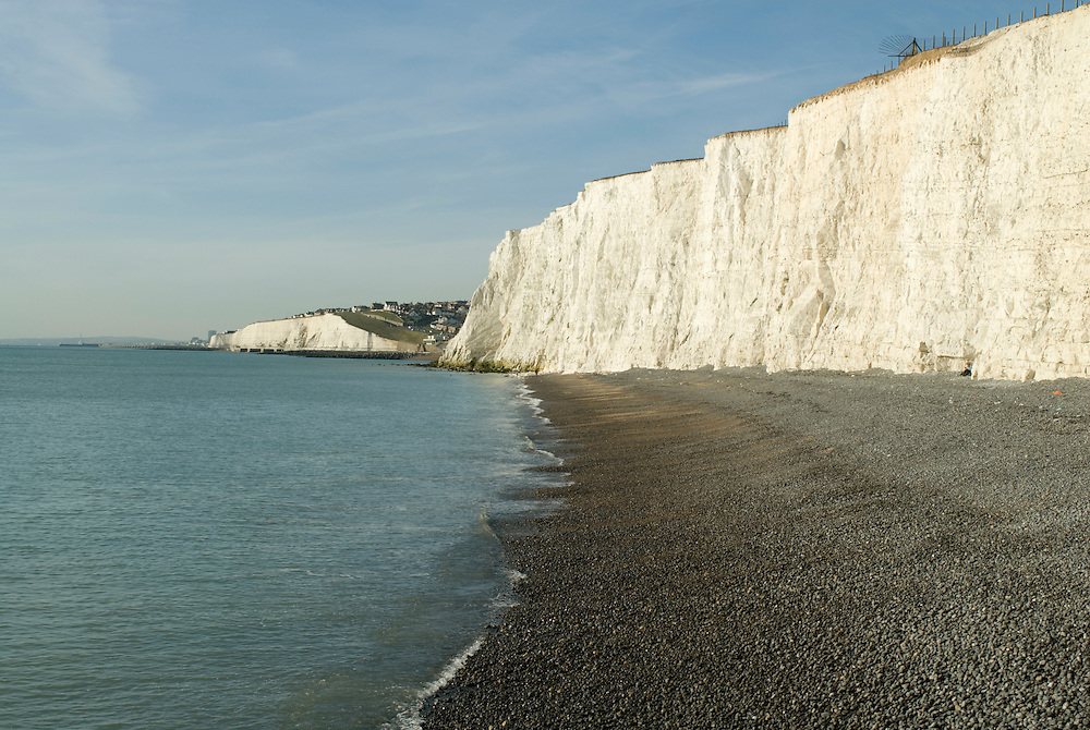 White cliffs at Telscombe on the East Sussex coast, looking West towards Brighton. Chalk cliffs are a noted geological feature of the South-East coast of England.