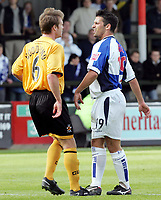 Fotball<br /> Foto: SBI/Digitalsport<br /> NORWAY ONLY<br /> <br /> Cambridge United v Bristol Rovers<br /> Coca-Cola Championship football league two<br /> Abbey Stadium 09/10/2004<br /> <br /> <br /> Bristol's Aaron Lescott and Cambridge's Warren Goodhind argue on the pitch.