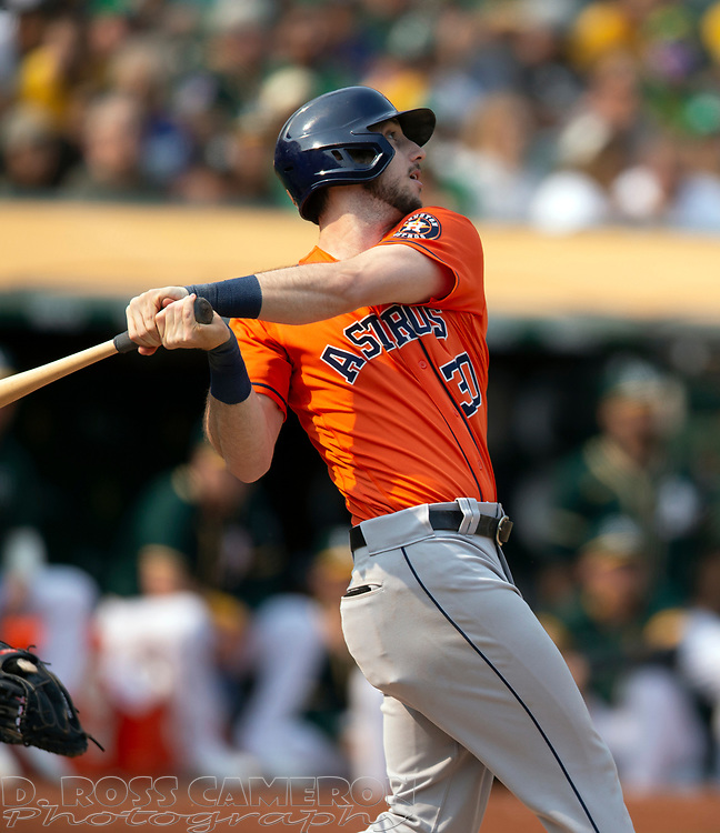 Sep 25, 2021; Oakland, California, USA; Houston Astros right fielder Kyle Tucker (30) follows the flight of his solo home run off Oakland Athletics starting pitcher Sean Manaea during the seventh inning at RingCentral Coliseum. Mandatory Credit: D. Ross Cameron-USA TODAY Sports