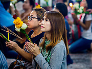31 MAY 2017 - CHACHOENGSAO, THAILAND: Women pray at Wat Sothon (also spelled Sothorn) in Chachoengsao, Thailand. The temple is one of the largest and most visited in Thailand. People make merit by paying to wrap the Buddha statues in orange robes. The temple is most famous because people leave hard boiled eggs as an offering at the temple. They ask for business success or children and leave hundreds of hard boiled eggs.      PHOTO BY JACK KURTZ